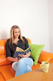 Young lady reading an old book Royalty Free Stock Photo