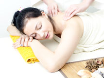 Young lady receiving back massage Stock Image