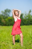 Young lady in red dress Stock Images