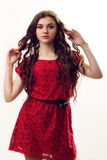 Young lady in red dress dancing on white background stock photo