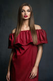 Young lady in red dress Royalty Free Stock Images