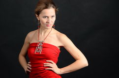 Young lady in a red dress. Young woman in a red dress looking down left side Stock Photos