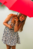 Young lady with red umbrella near the pond Royalty Free Stock Photography