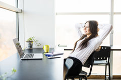 Young lady relax at her working place stock photos