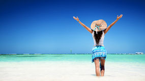 Young lady relaxing on a beach Stock Photo