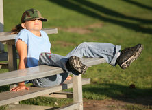 Young lady relaxing between innings. Young lady relaxing on stadium bleachers stock photos