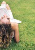 Young lady resting on the fresh lawn. Young lady resting on the fresh green lawn Stock Photography