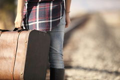Young lady with retro suitcase on railway. Travel Royalty Free Stock Images