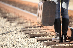 Young lady with retro suitcase on railway. Travel Stock Images