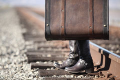 Young lady with retro suitcase on railway. Travel Royalty Free Stock Photos