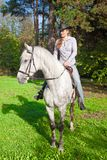 Young Lady riding a horse Stock Photography