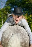 Young Lady riding a horse Stock Photo