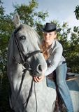 Young Lady riding a horse Royalty Free Stock Photography