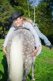 Young Lady riding a horse Royalty Free Stock Photo