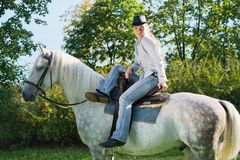 Young Lady riding a horse Stock Images