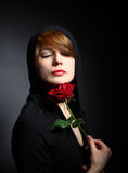 Young lady  with rose Stock Images