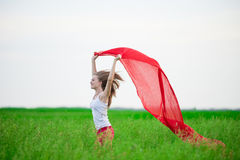 Young lady runing with tissue in green field Royalty Free Stock Photo