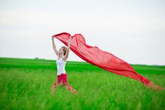 Young lady runing with tissue in green field Stock Images
