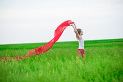 Young lady runing with tissue in green field Royalty Free Stock Images