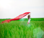 Young lady runing with tissue in green field Stock Photos