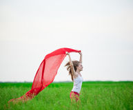 Young lady runing with tissue in green field Royalty Free Stock Photography