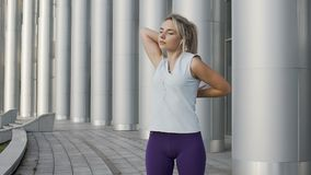 Young lady in running gear preparing to exercise in slow-motion, training day. Stock footage stock video footage
