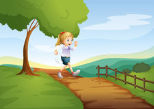 A young lady running hurriedly Royalty Free Stock Photo