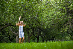 Young lady running in the meadow Royalty Free Stock Images