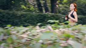 Young lady running stock footage