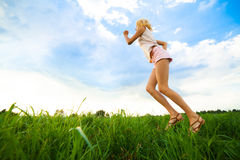 Young lady running on a rural road during sunset Royalty Free Stock Photos