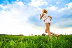 Young lady running on a rural road during sunset Royalty Free Stock Photo