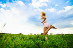 Young lady running on a rural road during sunset Royalty Free Stock Photography