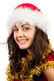 Young lady with Santa Claus hat. Close up of a young woman with Santa Claus hat isolated on white background Royalty Free Stock Image