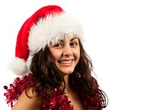 Young lady with Santa Claus hat. Close up of a young woman with Santa Claus hat isolated on white background Stock Image