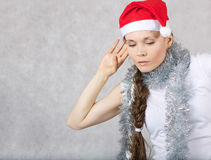 Young lady in Santas hat. Young lady in a Santas hat. Free space for a text Stock Images