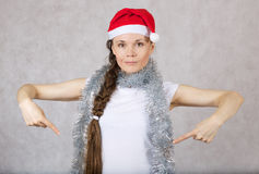 Young lady in Santas hat Stock Image