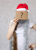 Young lady in Santas hat. Young lady in a Santas hat. Free space for a text Royalty Free Stock Images