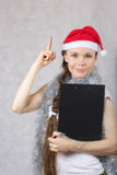 Young lady in Santas hat Stock Photography