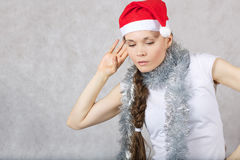 Young lady in Santas hat. Young lady in a Santas hat. Free space for a text Royalty Free Stock Photo