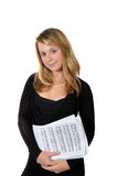 Young lady with scores on white background Stock Photography