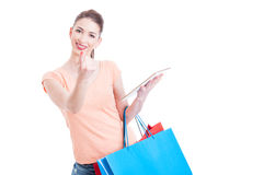 Young lady shopper making come here gesture holding tablet. As a online shopping invitation  on white background with advertising area Royalty Free Stock Photo