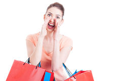 Young lady shopper shouting or yelling sales concept Stock Photos