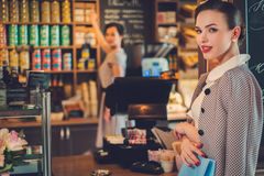 Young lady shopping in a bakery.  royalty free stock photography