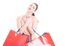 Young lady at shopping being happy accomplished and content. With bunch of bags isolated on white background with advertising area stock photography