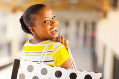 Young lady shopping. Cheerful african young lady in shopping mall Stock Photos