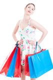 Young lady at shopping posing with gift bags Royalty Free Stock Photos