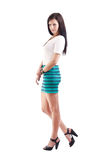Young lady in short skirt. Full length of a beautiful young lady in short skirt Royalty Free Stock Photography