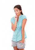 Young lady in shorts with hand on chin Royalty Free Stock Image