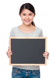 Young lady show with blank of balck board Royalty Free Stock Photos