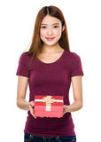 Young lady show wtih small gift Royalty Free Stock Photography